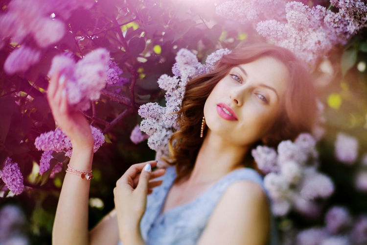 Lilac Flower Visual Creativity Beautiful Woman Beauty Flower Flowering Plant Fragility Headshot Leisure Activity Lifestyles Lila One Person Outdoors Plant Portrait Real People Spring Spring Flowers Springtime Women Young Women