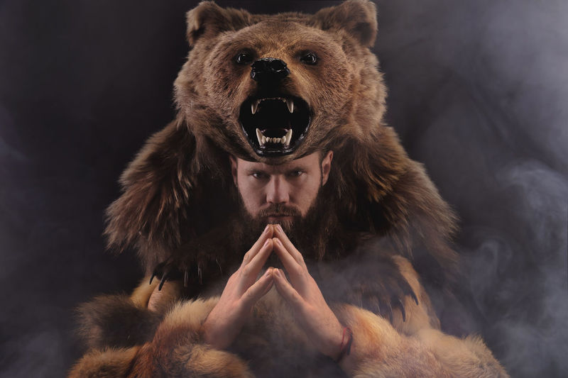 Portrait of man with bear costume