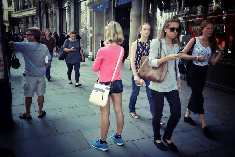 Full length of woman standing on sidewalk