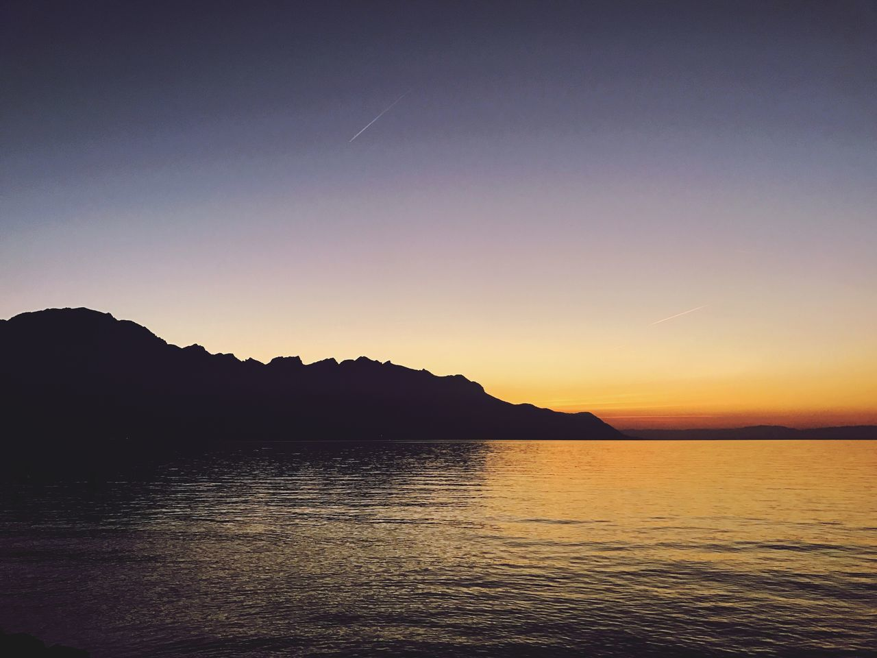 sunset, beauty in nature, scenics, tranquility, silhouette, tranquil scene, nature, no people, mountain, water, sky, sea, outdoors
