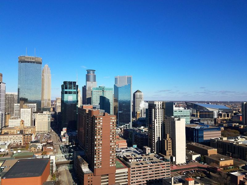 A different perspective than I usually have, seeing Minneapolis from a roof top downtown. Our fun here is focused not only on its downtown life but on its many gems: unique neighborhoods, community feeling, local food scene, lakes, beaches, & bakeries. Community Home Blue Clear Day Minnesota Skyscraper Cityscape City Architecture Urban Skyline Sky Modern City Life Downtown District Outdoors No People