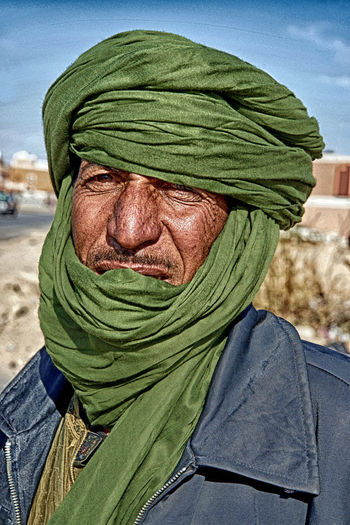 One Person Senior Adult Headshot Adult Men Portrait Clothing Males  Day Front View Close-up Senior Men Human Body Part Sky Lifestyles Headscarf Real People Human Face Green Color Mature Men Obscured Face Hood - Clothing Depression - Sadness Scarf
