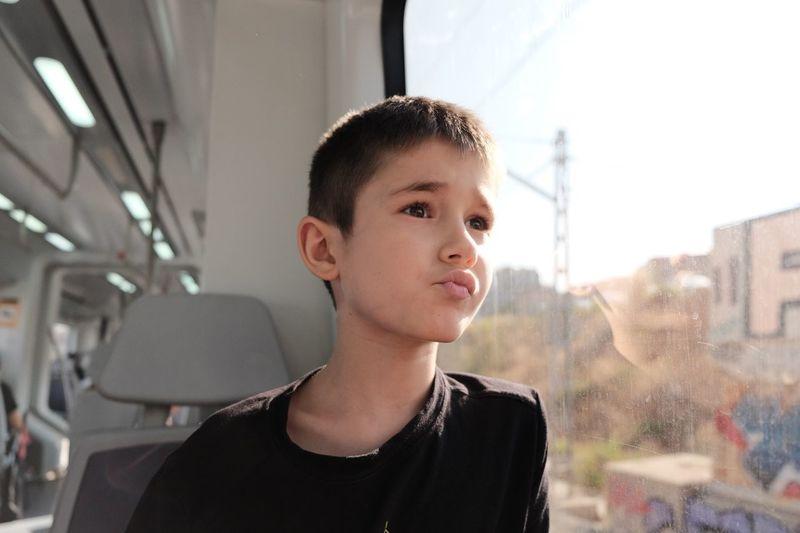 Cute boy sitting in bus