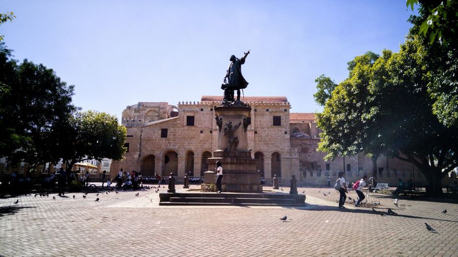 Parque Colon/Columbus Park Statue Sculpture Outdoors Sky Day Colonial Gothic Architecture Cathedral Santo Domingo Dominican Republic Park City Old Town Caribbean Heritage Spaniard Culture Photography Stockphoto Visit