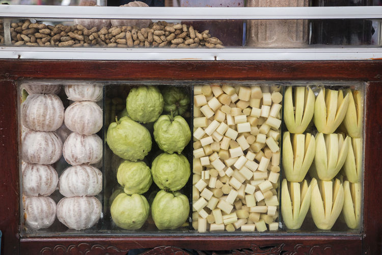 Close-up of fruits in display cabinet at store