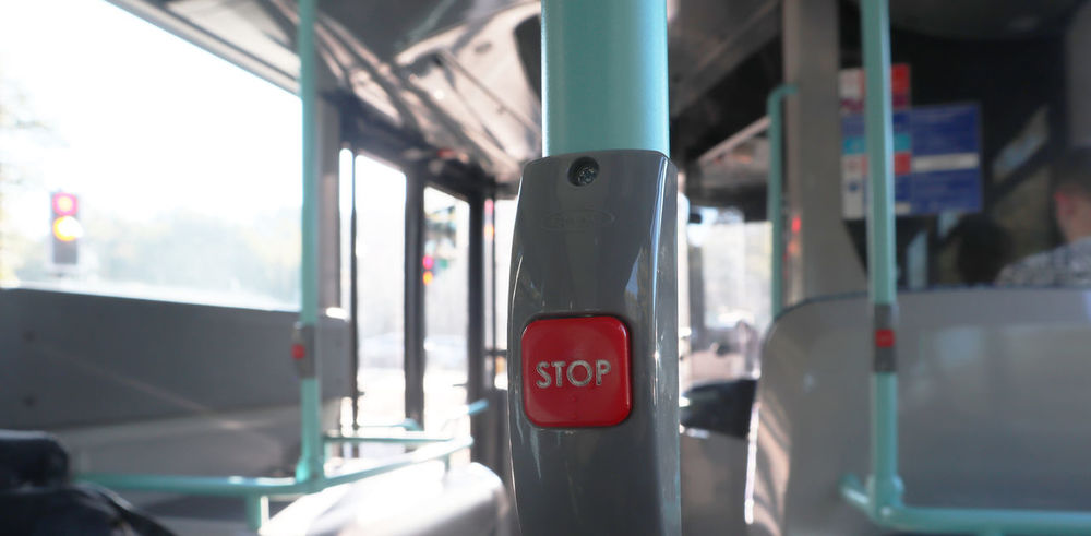Press on the red button to stop the bus Transportation Focus On Foreground Public Transportation Vehicle Interior Outdoors Red Bus Guidance Close-up Text No People Day Sign Stop Button Beauty In Nature