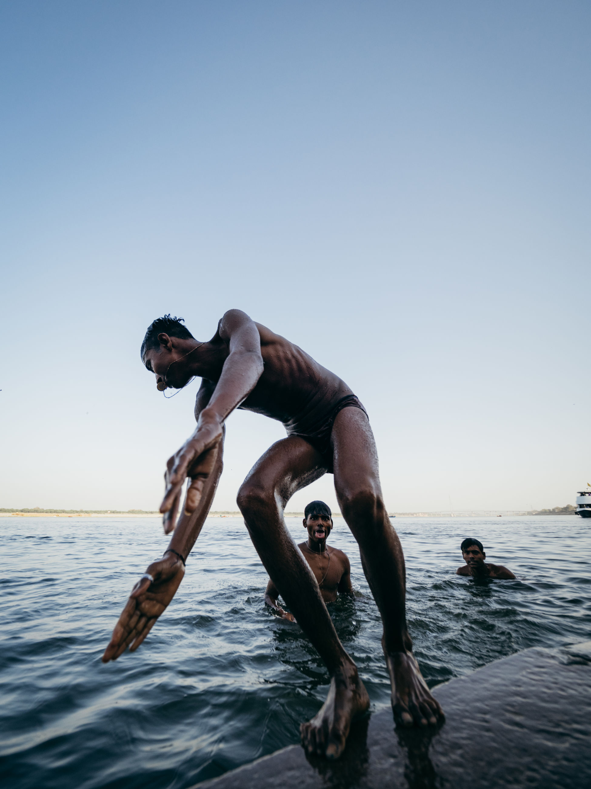 water, sky, sea, clear sky, men, shirtless, lifestyles, nature, real people, waterfront, leisure activity, people, horizon, copy space, horizon over water, young adult, young men, diving, sport