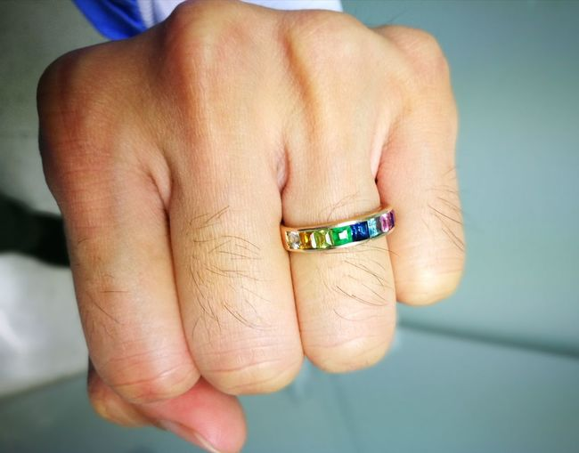 Cropped Image Of Fist Wearing Colorful Ring