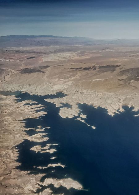 Lake Mead, a reservoir. Drainage Desert Rugged Landscape Western USA Infrastructure Lake Mead Reservoir Nature Tranquil Scene Beauty In Nature Landscape Scenics Tranquility No People Physical Geography Blue Arid Climate Sunlight Shadow Outdoors