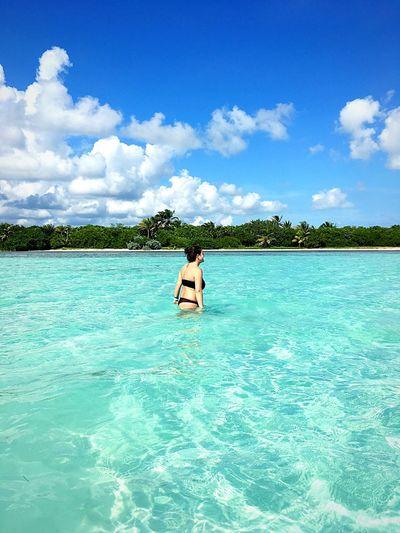 Bikini Woman Standing In Sea Against Cloudy Sky