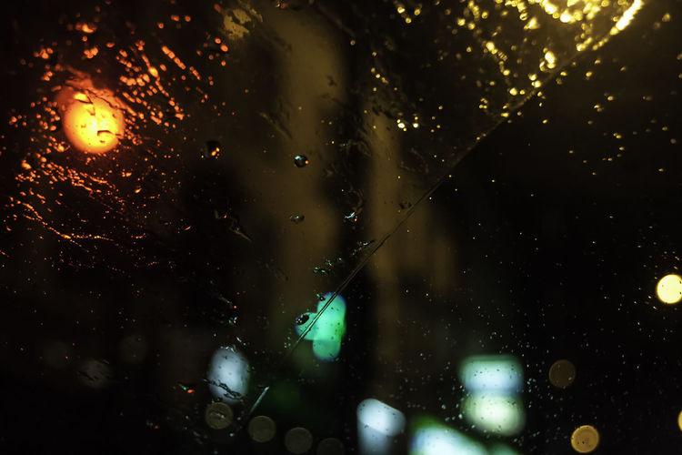 Rain RainDrop Bokeh Bokeh Photography Car Car Light Car Window Close-up Drop Focus On Foreground Glass Glass - Material Illuminated Night No People Rain Rain On Car Rain On Car Window Rain On Window Rainy Season Vehicle Interior Water Wet Window Windsheild