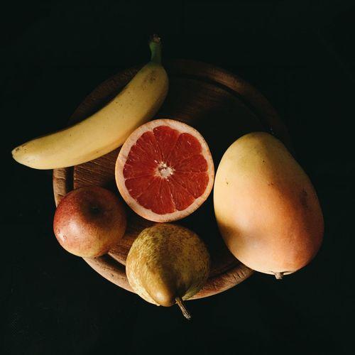 Close-up of fruit over black background