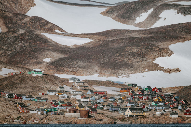 Remote Arctic settlement, Ittoqqortoormiit Greenland Houses Ittoqqortoormiit Remote Location Architecture Arctic Building Building Exterior Built Structure Coast Coastal Crowd Day Environment High Angle View House Land Mountain Nature Outdoors Residential District Rock Scenics - Nature Scoresby Sound Scoresby Sund Town Travel Travel Destinations Village
