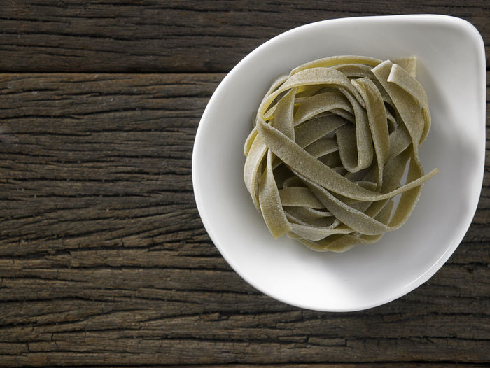 Close-up of tagliatelle pasta on table