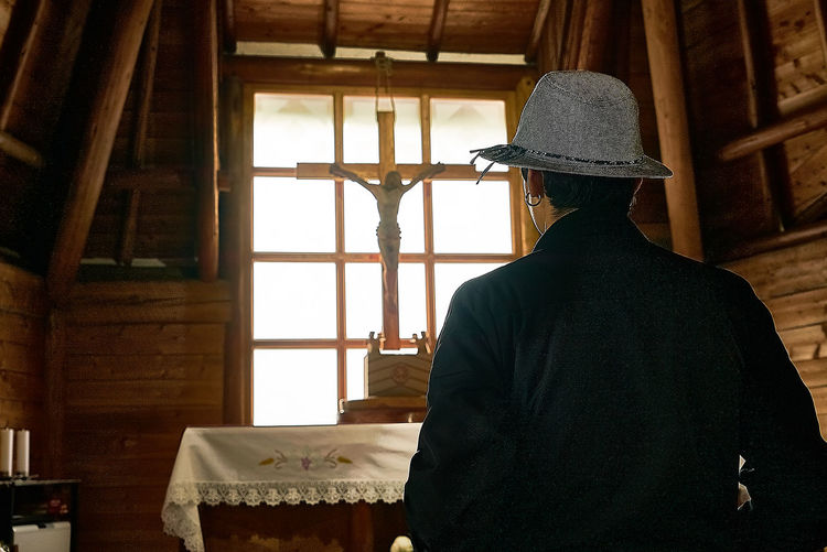 Rear view of man standing in church