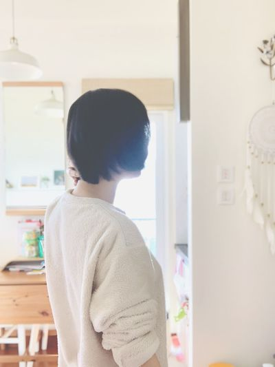 Rear view of woman looking at home