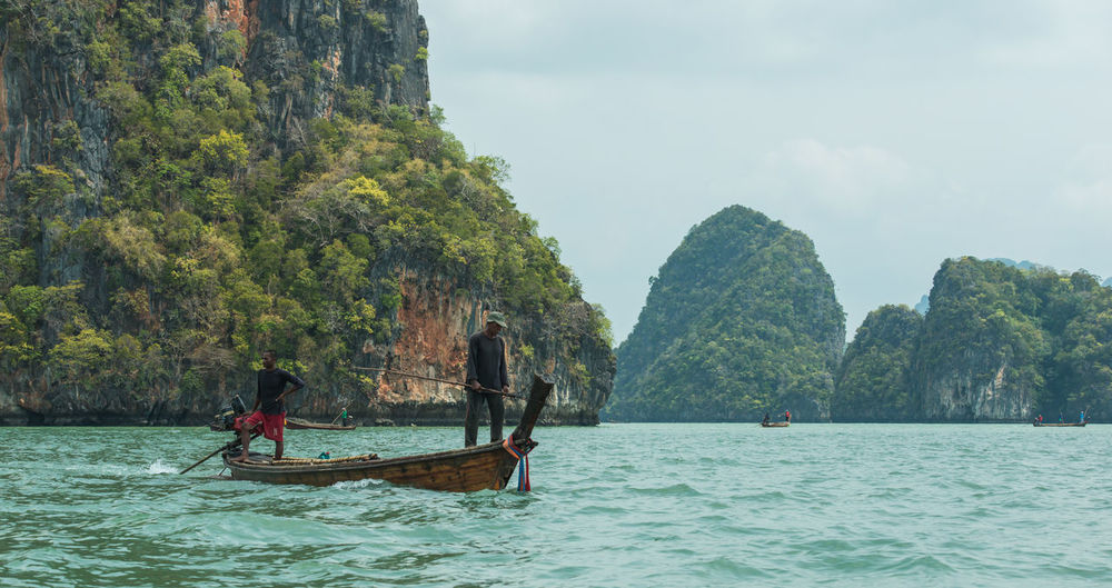 Fisherman, Phang-Nga, Thailand Adult Adults Only Beauty In Nature Day Longtail Boat Men Mode Of Transport Nature Nautical Vessel Outdoors People Scenics Sea Sky Tourism Transportation Travel Travel Destinations Tree Vacations Water