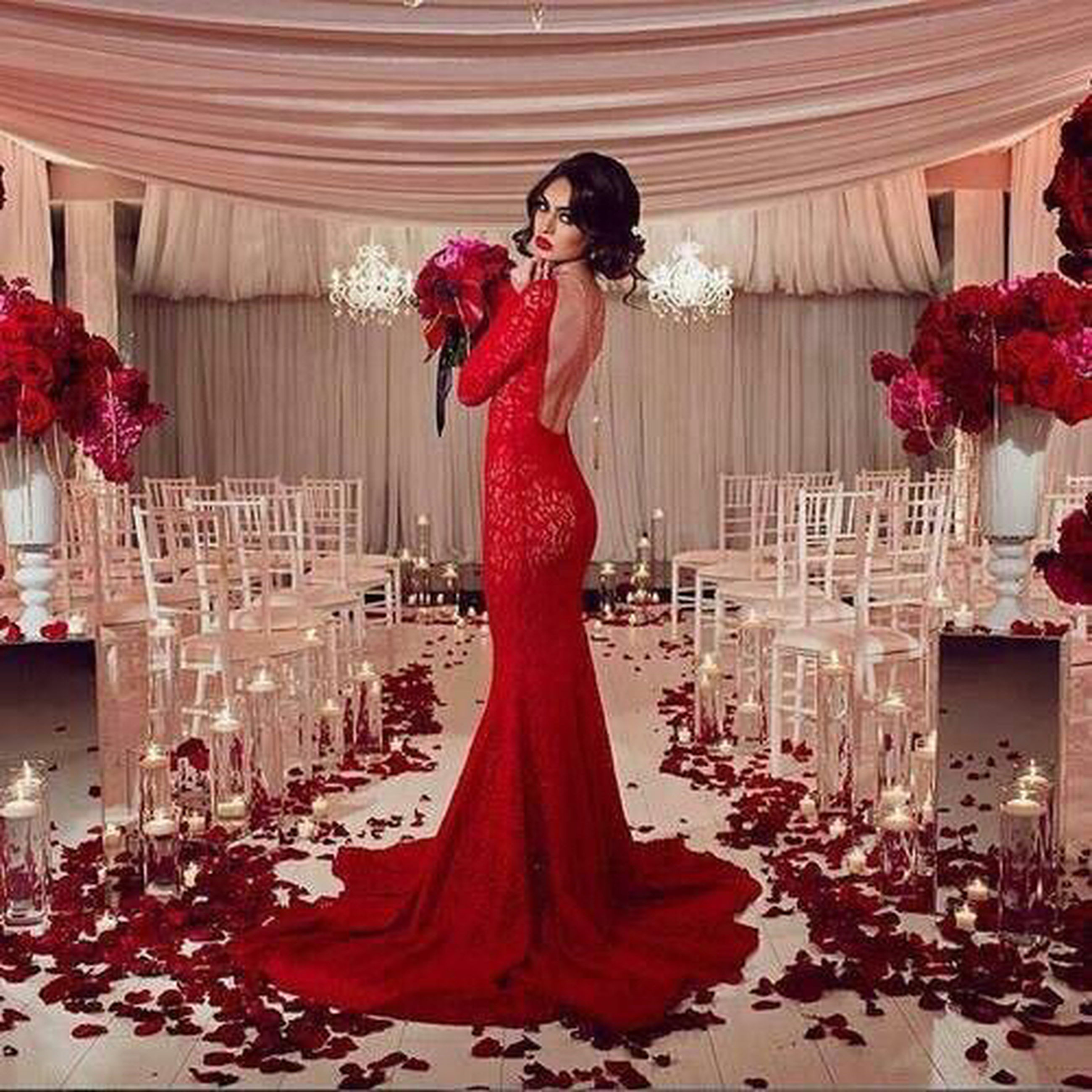 lifestyles, indoors, young women, young adult, leisure activity, dress, standing, traditional clothing, casual clothing, person, flower, red, celebration, built structure, full length, architecture
