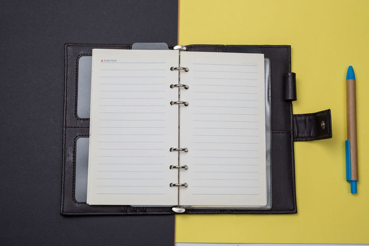 No People Note Pad Indoors  Pen Book Publication Open Paper Page Office Supply Yellow Education Still Life Close-up Communication Table Writing Instrument Directly Above Office Diary Blank