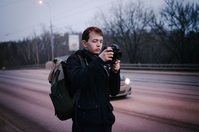 Full length of man photographing in winter