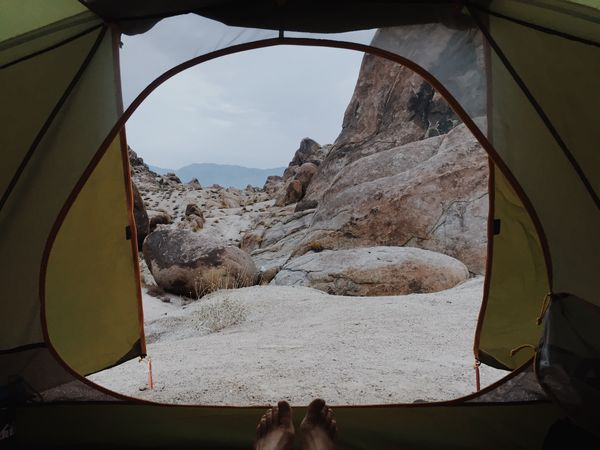 Campers feet in a tent in the mountains of the Alabama Hills in the desert of California Adventure Exploring Outside Camp Camping Nature Sky Body Part Day Low Section Human Body Part Personal Perspective Outdoors Lifestyles Tent People Land Human Foot