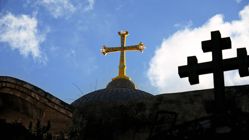 Architecture Built Structure Cloud - Sky Cross Crucifix Day Holy Land Holy Sephulchre Holy Sepulchre Jerusalem Jerusalem Israel Low Angle View No People Outdoors Place Of Worship Religion Sepulcher Sepulchre Sky Spirituality An Eye For Travel