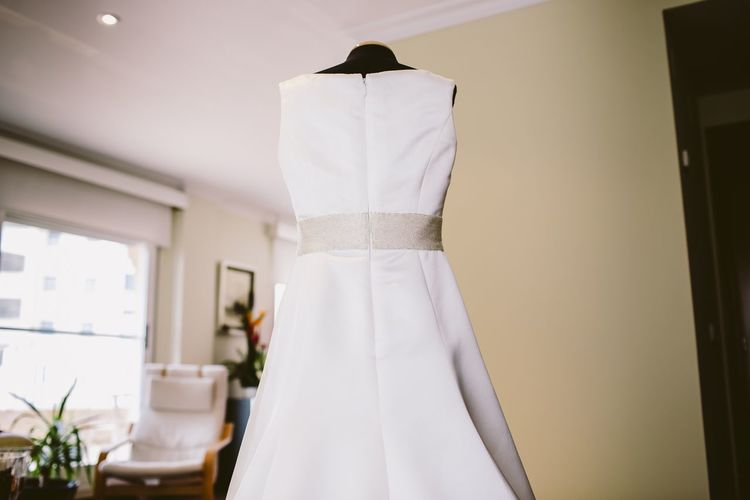 Wedding dress on mannequin at home