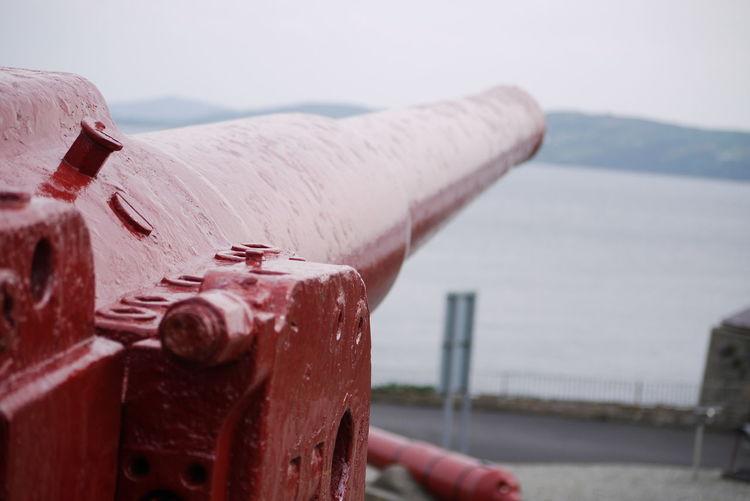 Cannon on dunree fort against sea