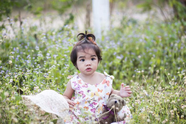 Portrait of cute girl in field