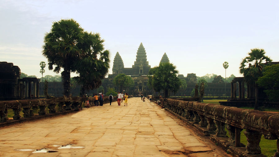 Ruins of Angkor, Angkor Wat, Siem Reap, Cambodia Cambodia Magical Place Ruins Siem Reap Tourist Attraction  Travel Travel Photography Traveling Ancient Ancient Civilization Angkor Angkor Wat Architecture Attraction Beauty In Nature Building Exterior Built Structure Day History Large Group Of People Lifestyles Men Nature Outdoors Palm Tree People Place Of Worship Real People Religion Ruins Architecture Siemreap Sky Southeast Asia Spirituality Temple Temple - Building Temple Ruins Tourism Tourist Destination Travel Travel Destinations Tree Women
