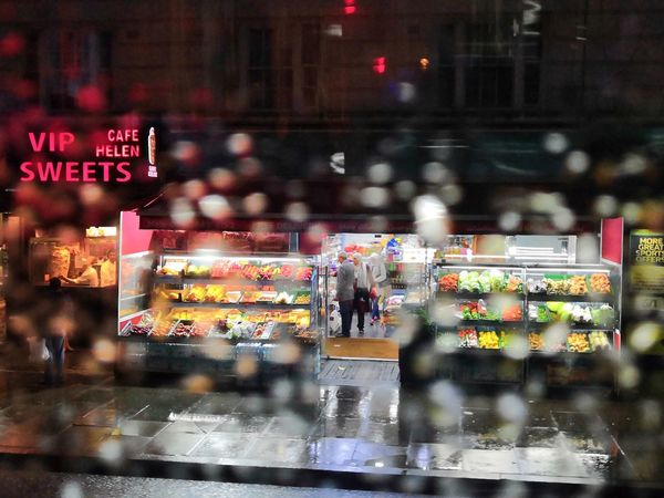 Colors in the rain City Cityscape Illuminated Urban Skyline Neon Nightlife Multi Colored Arts Culture And Entertainment Crowd City Life Commercial Sign Store Sign