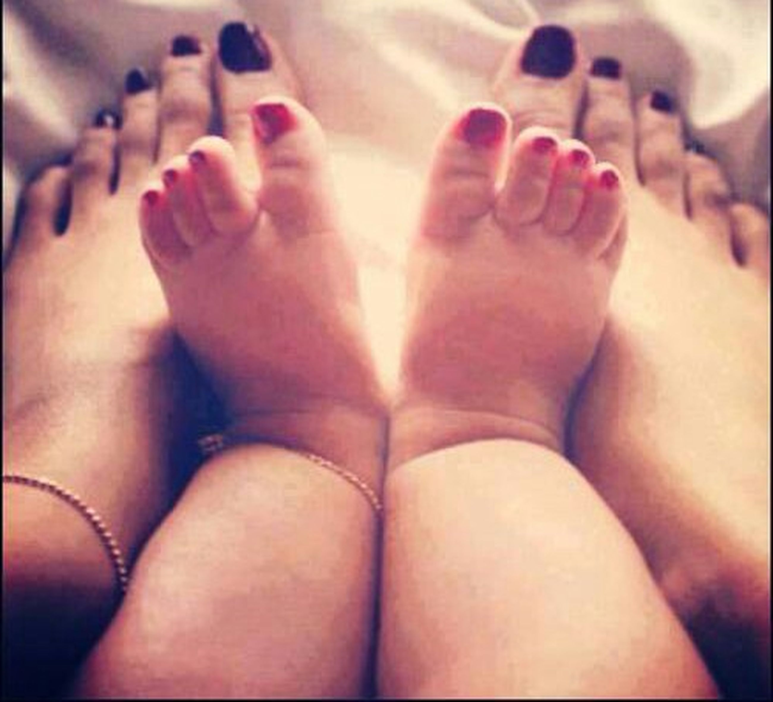 person, indoors, part of, lifestyles, leisure activity, togetherness, love, close-up, barefoot, low section, bonding, human finger, personal perspective, human foot
