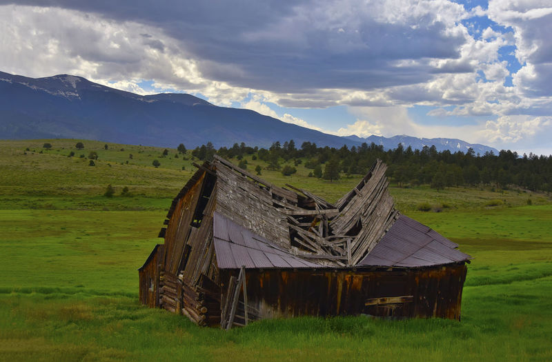 Old collapsed barn in rural Southern Colorado Architecture Colorado Farm Abandoned Beauty In Nature Cloud - Sky Day Environment Field Grass Land Landscape Mountain Nature No People Outdoors Rural, Scenics - Nature Sky Tranquil Scene Tranquility