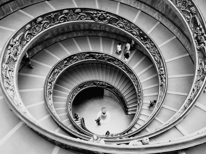 High Angle View Of People Walking On Spiral Staircase In Vatican Museums