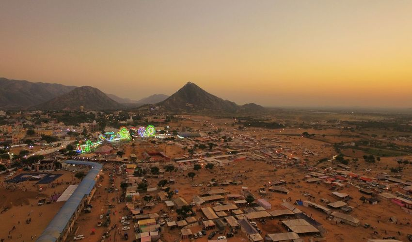 My Year My View Droneshot Aerial View Pushkar Pushkarcamelfair Dawn Landscape I visited Pushkar Camel Fair and after it ive adopted to this city. I took this photo at the dawn or the sunset from my Phantom 3 showing the entire mela or fair ground. Trust me it came as just magic. Finding New Frontiers Adapted To The City Adapted To The City Flying High The Photojournalist - 2018 EyeEm Awards