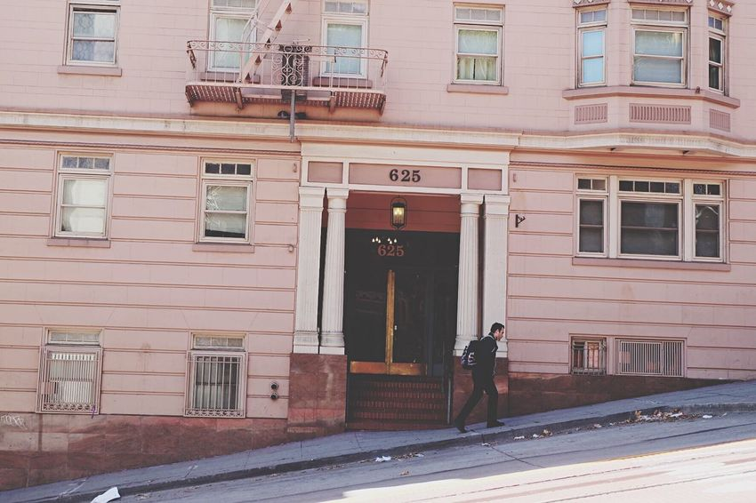 Up the hill by the pink house. Architecture Building Exterior Window Built Structure Walking City Life San Francisco Pink Textures And Surfaces City Building Street People And Places The Street Photographer The Street Photographer - 2017 EyeEm Awards