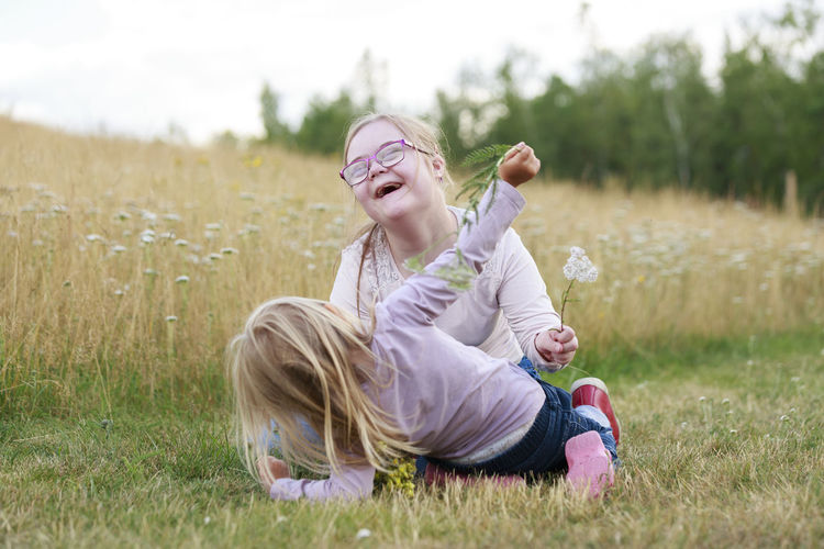 Smiling girl sitting on field
