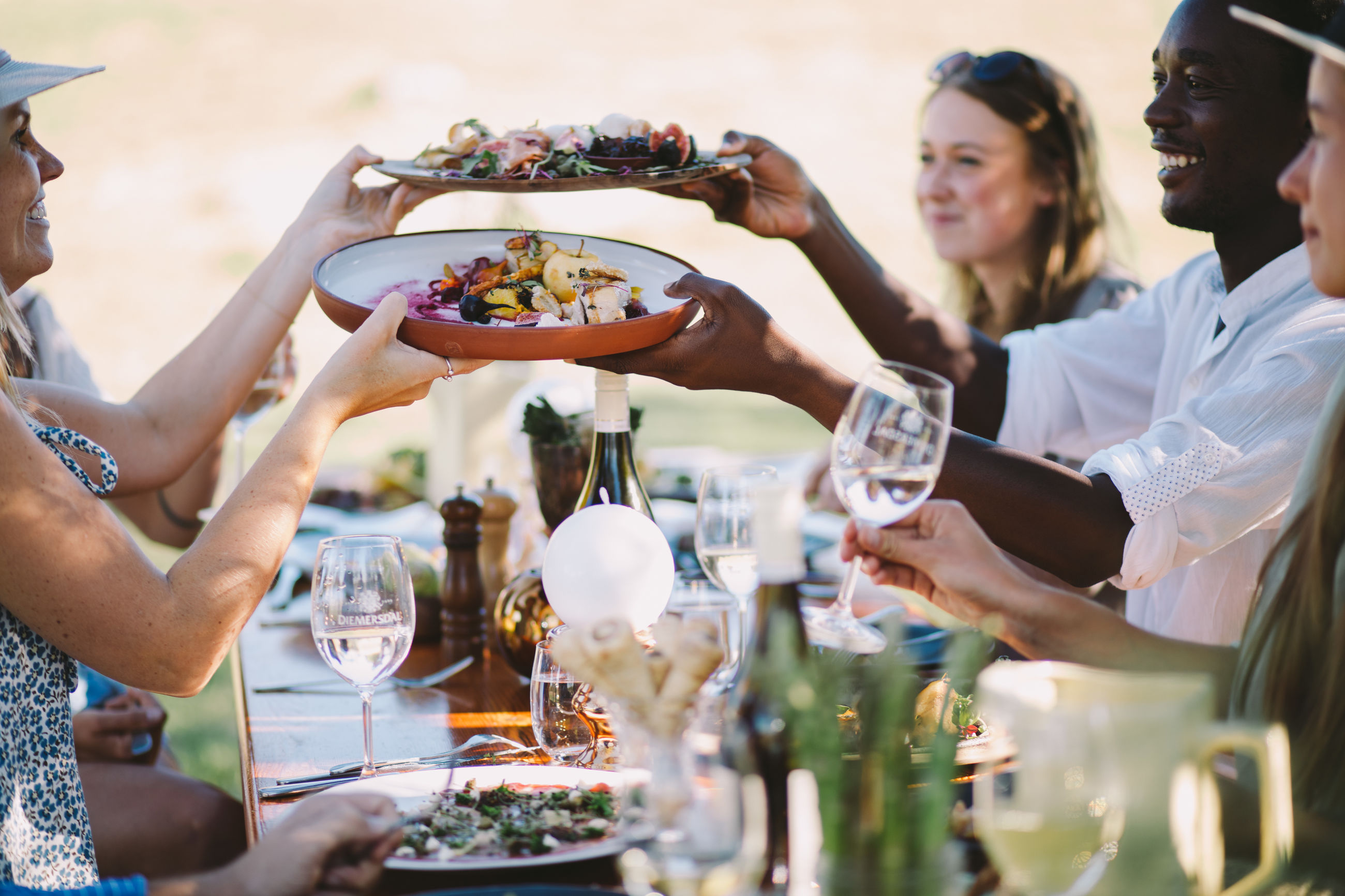food and drink, group of people, alcohol, glass, refreshment, celebration, real people, food, wine, men, friendship, adult, holding, lifestyles, women, drink, wineglass, business, smiling, hand, dinner, dinner party