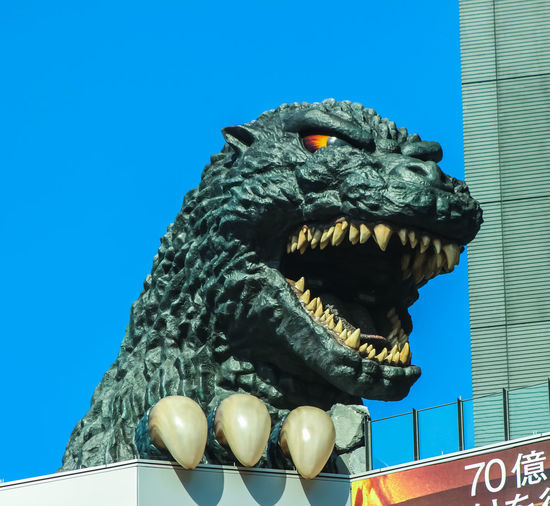 The life-sized head of Godzilla in Tokyo Japan. Clear Sky Curtis Egan Giant Monster Godzilla Japan Low Angle View Statue Tokyo