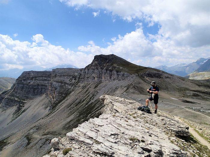 Full length of man on rocks against sky