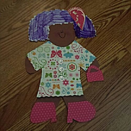 D's Gingerbread Girl--her self portrait. Yes. I insisted on the Miche bag.