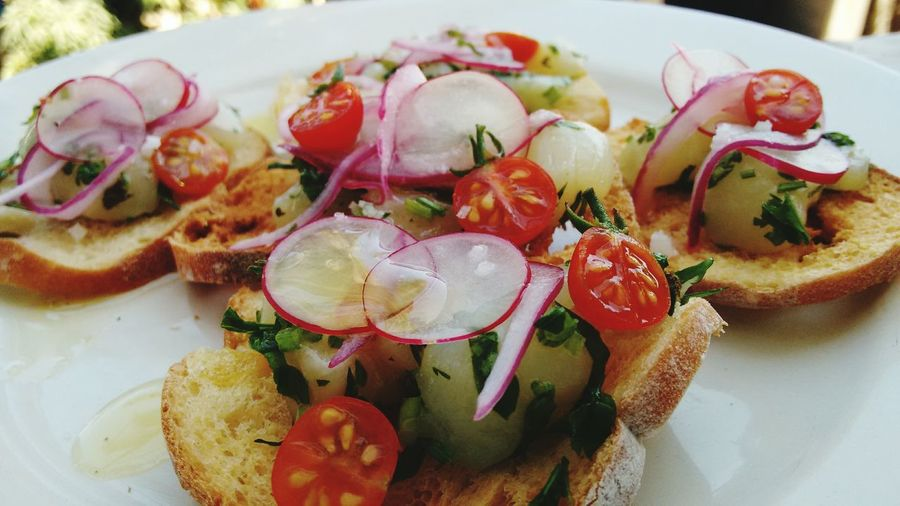 Close-up of bruschetta bread with toppings