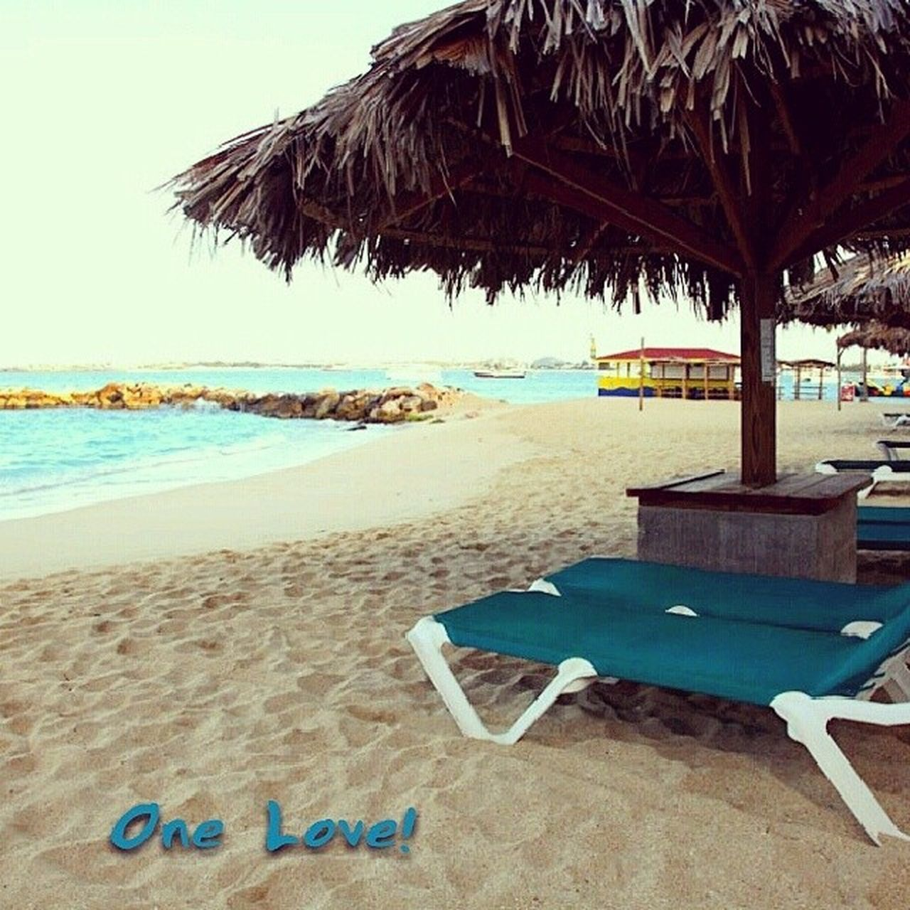 beach, sand, sea, shore, day, thatched roof, vacations, chair, tranquility, tranquil scene, no people, water, outdoors, horizon over water, relaxation, nature, scenics, clear sky, beauty in nature, sky