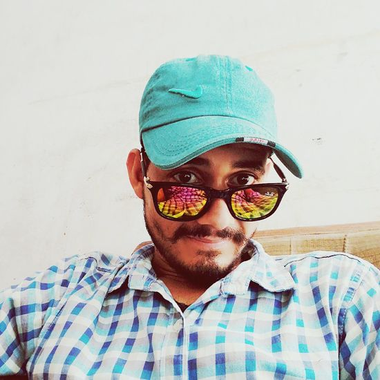 Sunglasses Eyeglasses  Cool Attitude Portrait Young Adult One Person Fashion Adult Only Men Headshot Looking At Camera One Young Man Only People One Man Only Eyewear Real People Multi Colored Day Outdoors Baseball Cap First Eyeem Photo