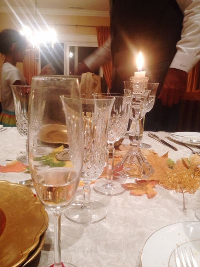 Thanksgiving Day Food And Drink Table Drinking Glass Celebration Alcohol Drink Wine Restaurant Indoors  Men Wineglass Human Hand Candle Food Burning Refreshment Human Body Part Night Champagne Flute