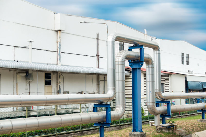 Steam pipelines Construction Distribution Liquid Steam Architecture Building Building Exterior Connection Day Design Engineering Equipment Factory Factory Building Industial Industry Manufacturing Metal Omega Loop Outdoors Pipe - Tube Pipe Support Sky Valves White