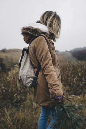 Adult Adults Only Adventure Blond Hair Day Hiking Landscape Nature One Person One Woman Only Outdoors People Rear View Rucksack Sky