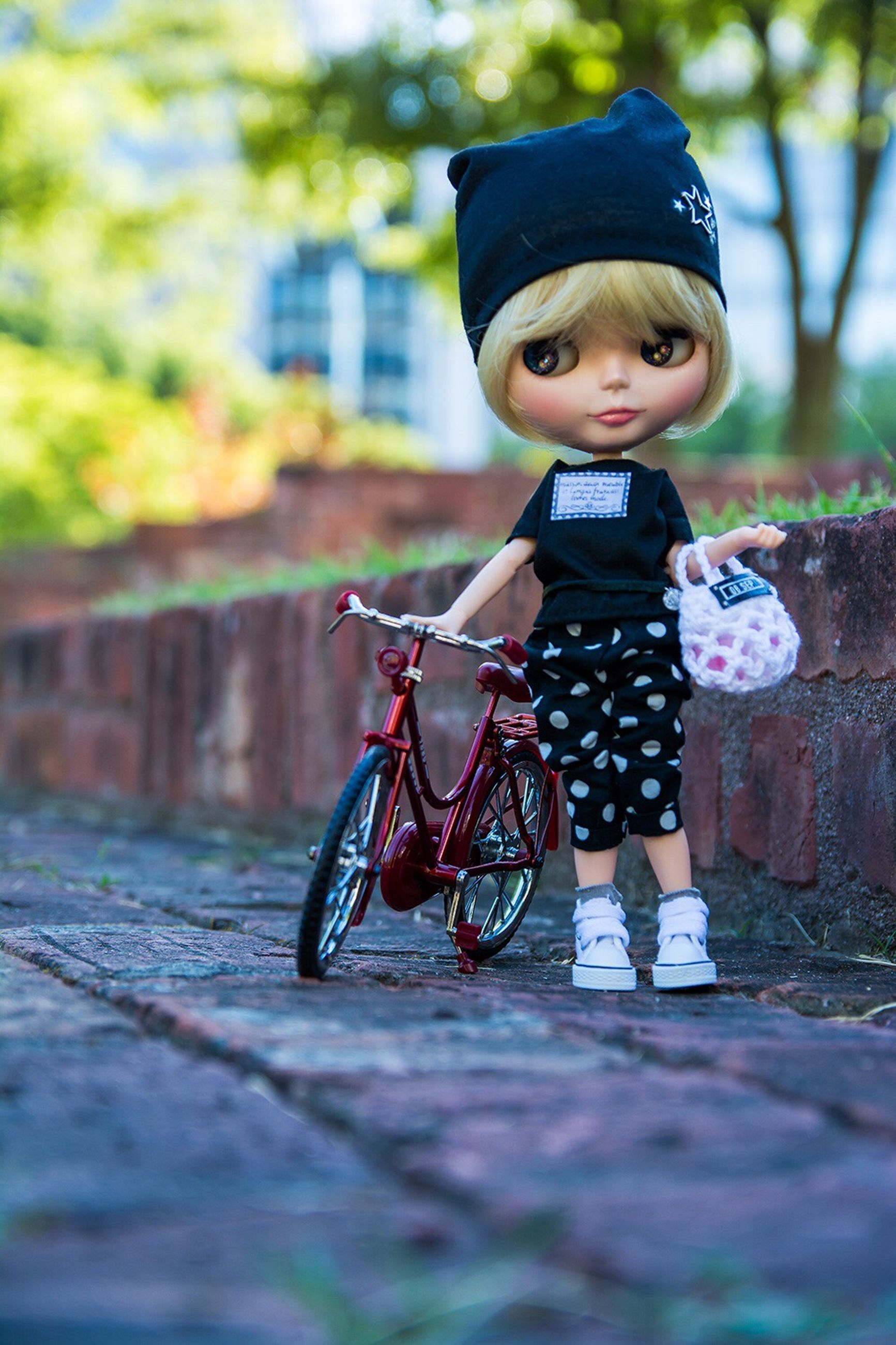 childhood, bicycle, leisure activity, elementary age, selective focus, lifestyles, cute, boys, transportation, casual clothing, holding, full length, mode of transport, riding, surface level, person, looking at camera, focus on foreground, day, innocence, outdoors