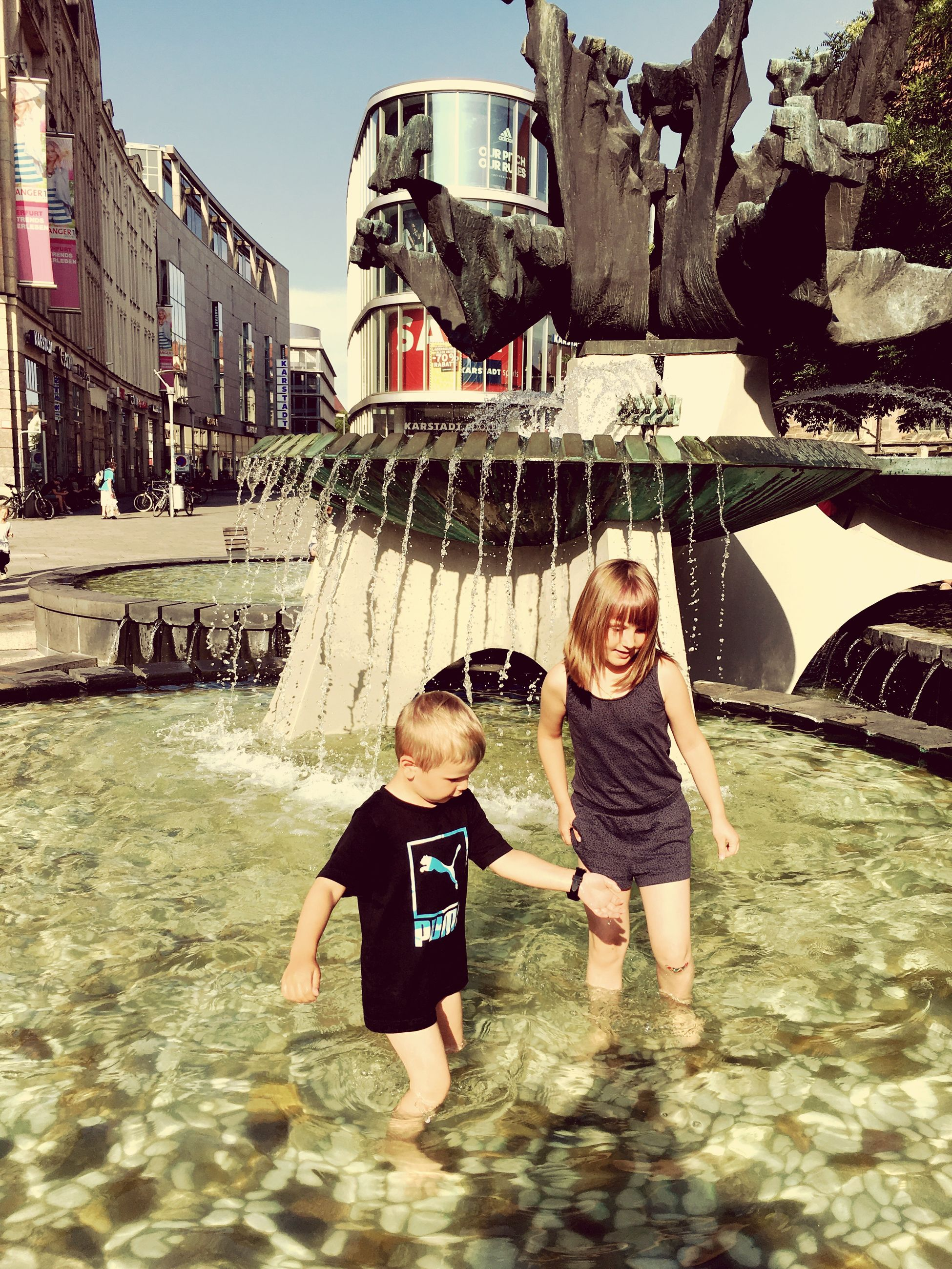 childhood, togetherness, boys, building exterior, built structure, architecture, girls, elementary age, bonding, leisure activity, family, lifestyles, casual clothing, sibling, playing, city, day, person, outdoors, single mother