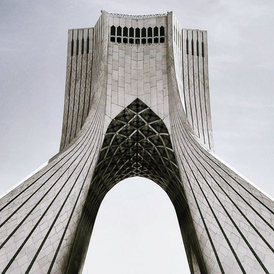 Travel Destinations Architecture History Tourism Tower Travel Built Structure City Skyscraper Building Exterior Outdoors Day Modern Urban Skyline No People Sky Politics And Government Iran Tehran